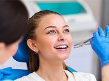 Girl getting a tooth removed at dental office